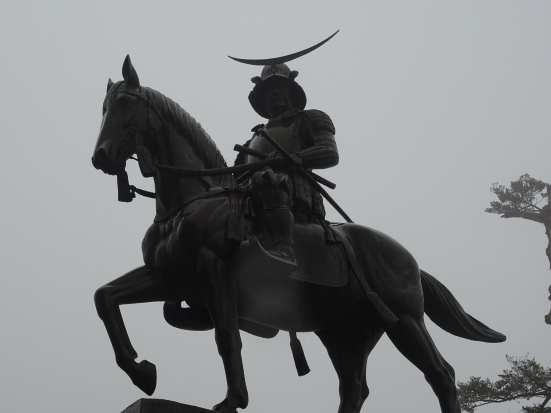 The statue in all its rainy glory
