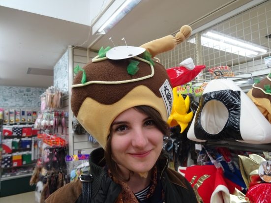 Novelty takoyaki hats, as modelled by Oana